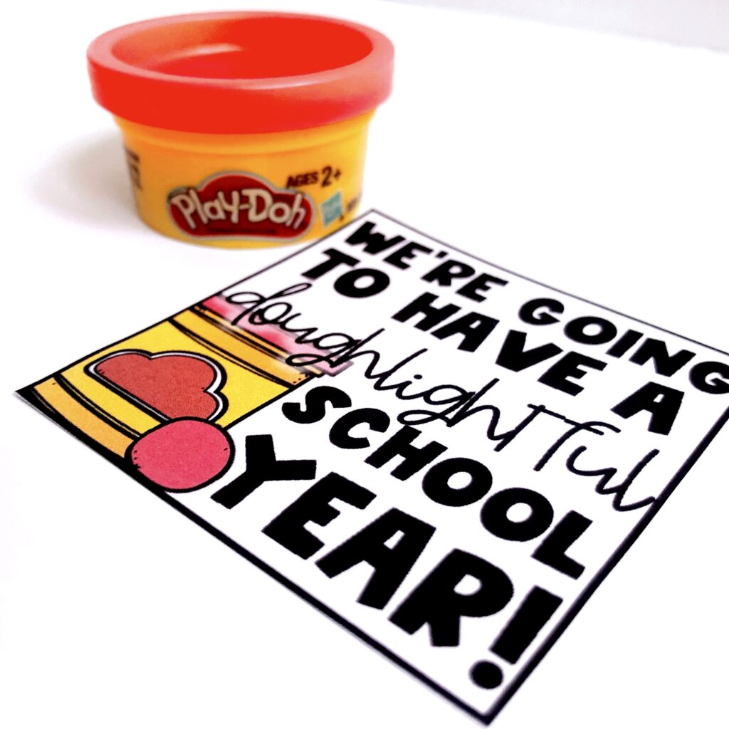 7 Easy and Inexpensive Back-to-School Gifts post image of a container of playdoh and a tag that says we're going to have a doughtlightful school year